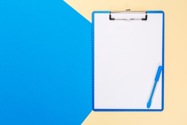 Blank paper notepad on bright bicolor surface, top view