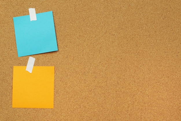 Blank paper notes stick on cork board. cork board with blank post it. sticker empty note.