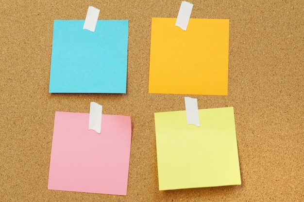 Blank paper notes stick on cork board cork board with blank post it