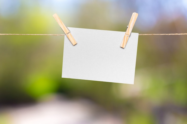 Blank paper notes with copy space pinned on rope