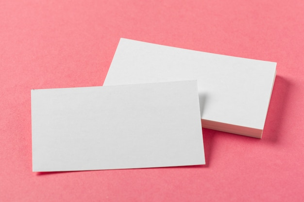 Blank paper pieces  on a colored pink surface