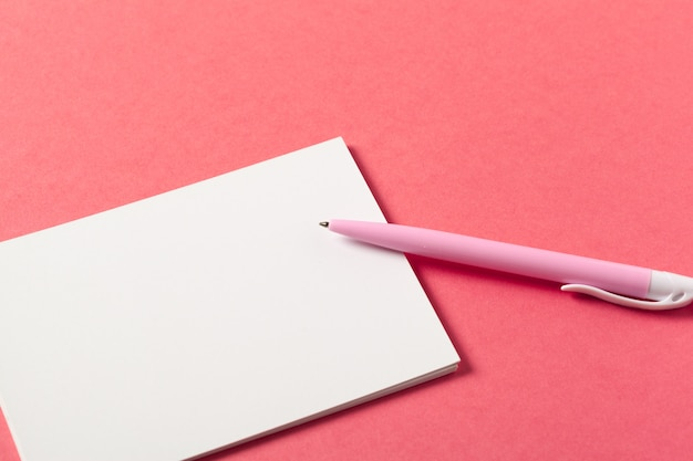 Blank paper pieces on a colored pink