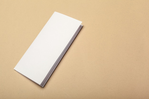Blank paper pieces for mock up on a beige background
