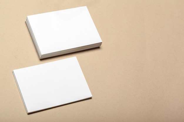 Blank paper pieces for mock up on a beige