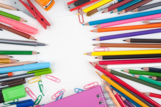 Blank paper and school or office tools  on white background