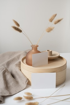 Blank paper sheet cards with rabbit tail grass, wooden casket and grey linen blanket.