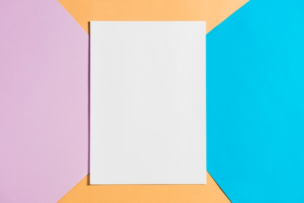 Blank paper sheet on colorful papers backdrop