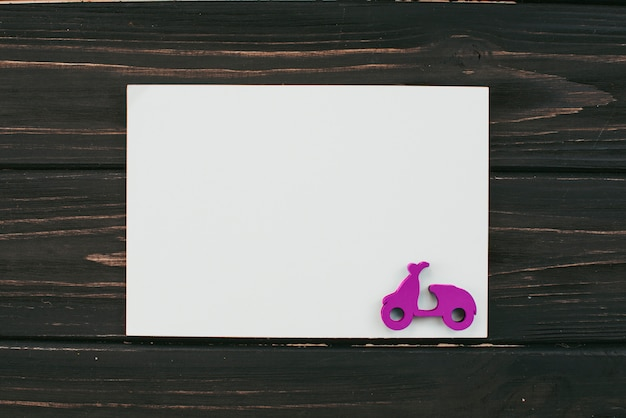 Blank paper sheet with small scooter