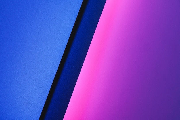 Blank paper sheets rolled in a neon purple lighting