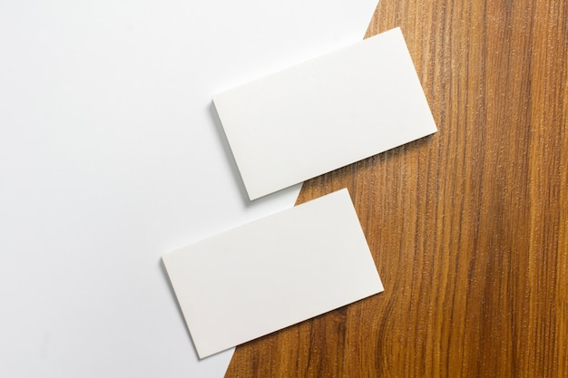 Blank paper stationery set on wooden desk