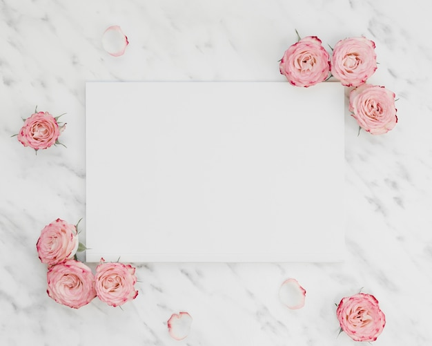 Blank paper surrounded by flowers