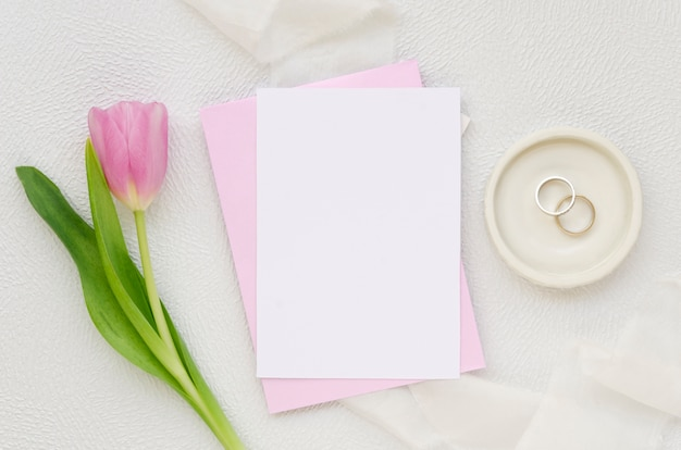 Blank paper and tulip flower