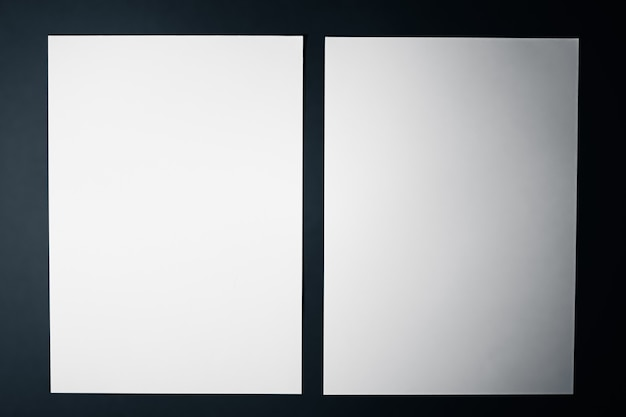 Blank a paper white on black background as office stationery flatlay luxury branding flat lay and br...