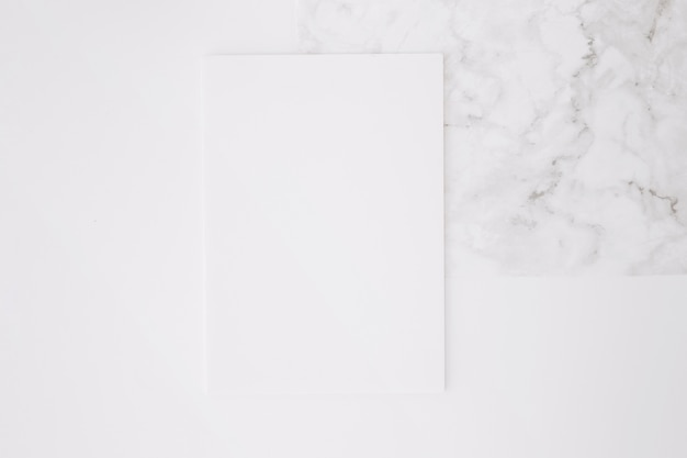 Blank paper on white desk background