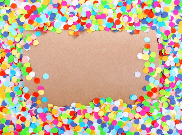 Blank paper with confetti around, party background