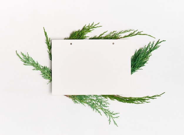 Blank paper with decorations on white background