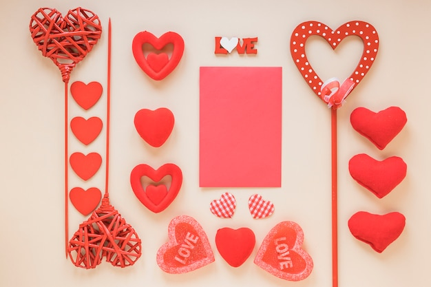 Blank paper with different hearts on light table