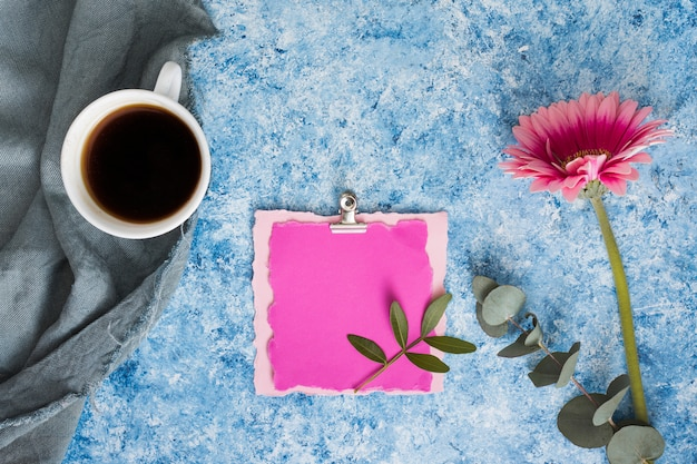 Blank paper with gerbera flower and coffee