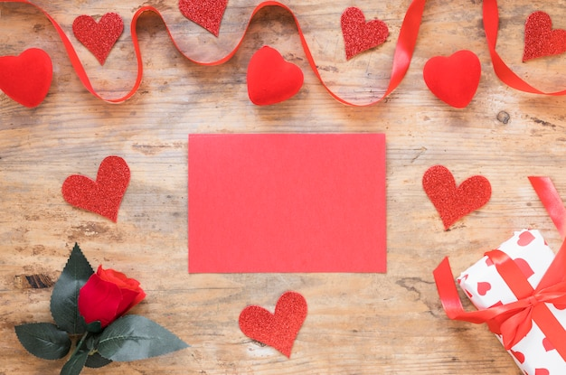Blank paper with small hearts on table