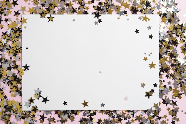Blank paper with small spangles on table