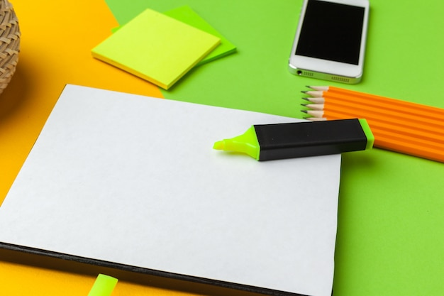 Blank paper with smart phone on desk
