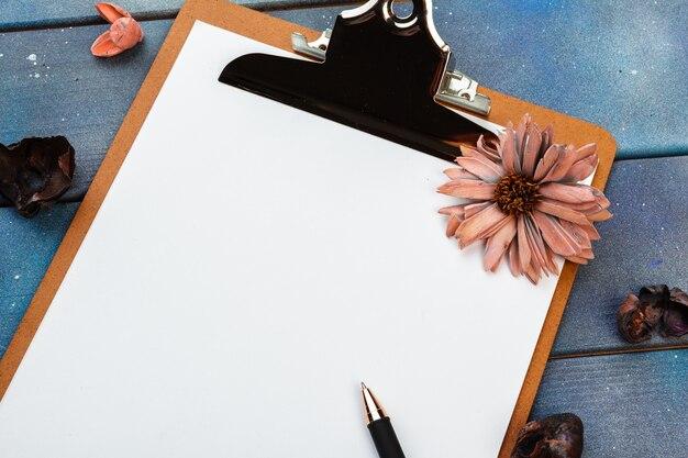 Blank paper on wooden clipboard