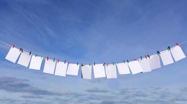 Blank papers on a clothesline