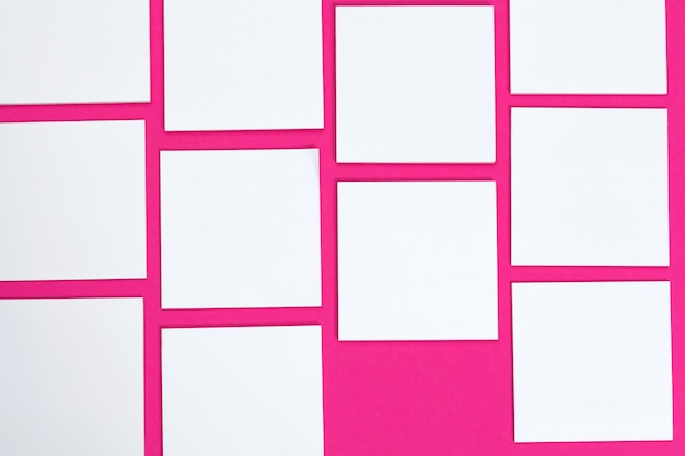 Blank papers on pink background