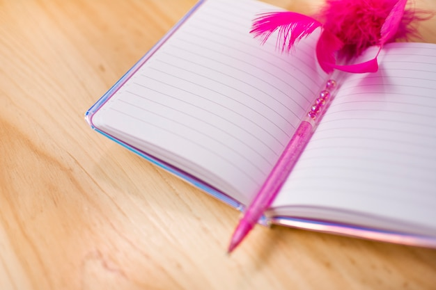Blank personal diary on wooden background