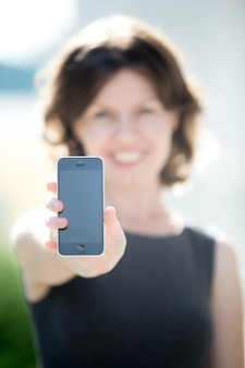 Blank phone screen in hands