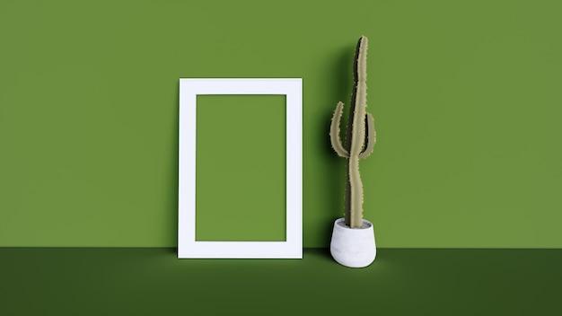 空白のフォトフレームと緑の壁とサボテンの木