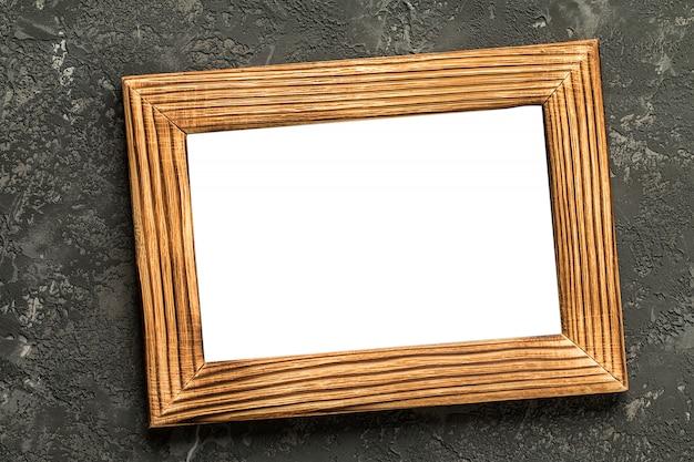 Blank photo frame on black concrete