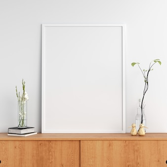 Blank photo frame on cabinet