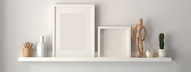 Blank photo frame and decorations on shelf with white wall