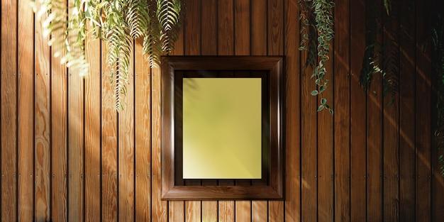 木製の壁に掛かっている空白のフォトフレーム