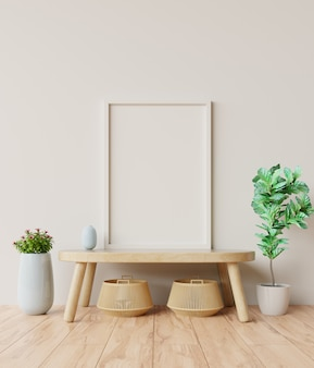 Blank photo frame in the interior room on table.