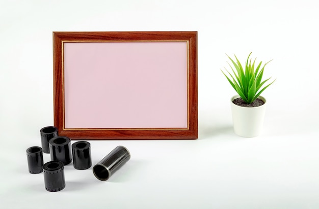 Blank photo frame, photographic film on the table.make up.