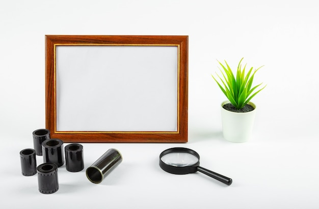 Blank photo frame, photographic film on the table. make up.
