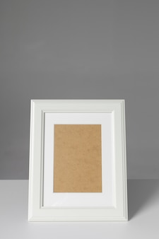 Blank photo frame on the table