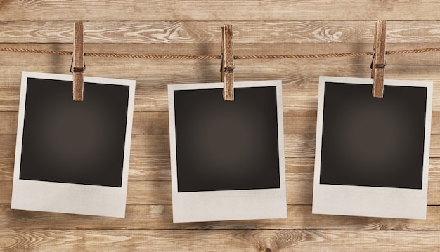 Blank photo frame on wooden background