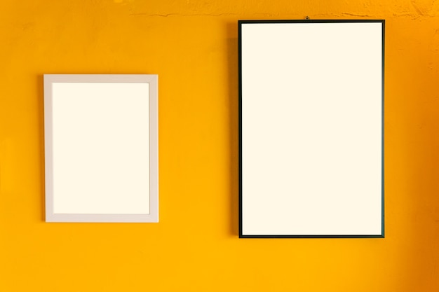 Blank photo frame on the yellow vintage wall
