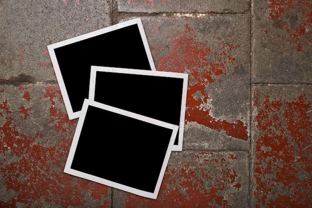 Blank photo frames on grunge floor