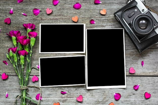 Blank photo frames with vintage retro camera and purple flowers
