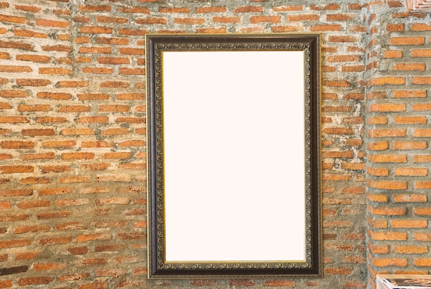 Blank photo vintage frame on the old brick wall