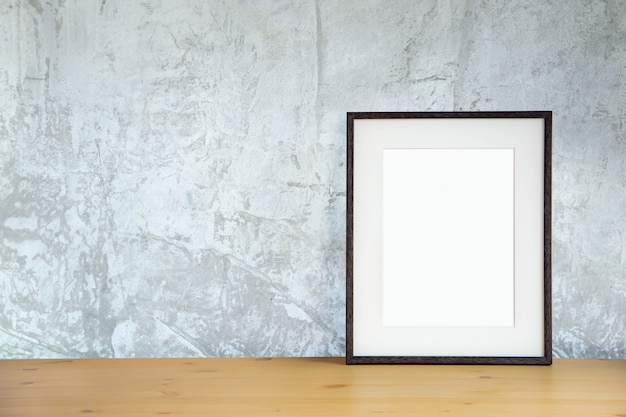 Blank picture frame on the cement wall and the wooden floor, template poster interior photo 3d background