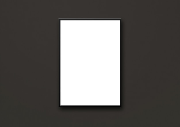 Blank picture frame hanging on a black wall. presentation mockup template