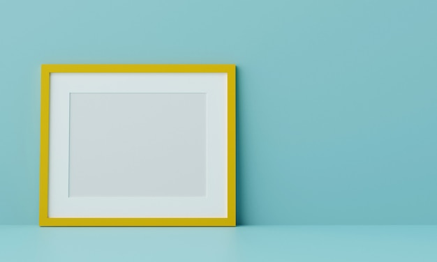 Blank picture frame mock up on the blue wall. 3d rendering.