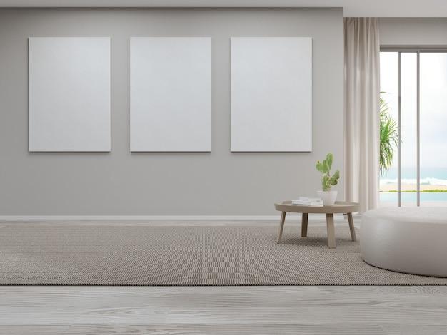 Пустая рамка для картин возле журнального столика на коричневом ковре большой гостиной в современном доме