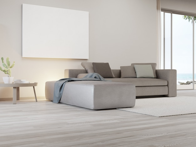 Blank picture frame near sofa on carpet of large living room in modern house or luxury villa
