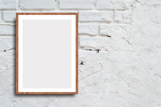 白いレンガの壁の空の画像フレーム